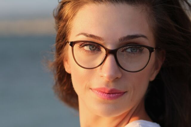 girl smiling with glasses