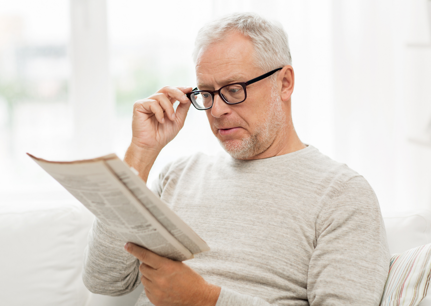 man reading with glasses